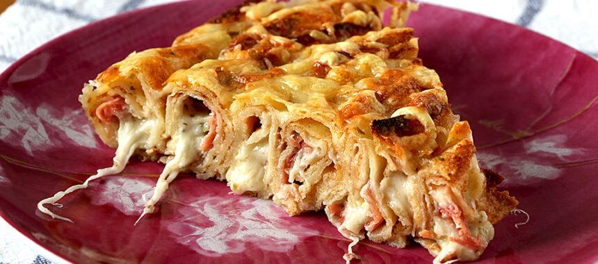 Pastel de crepes salado relleno con jamón serrano y queso